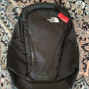 The North Face vault black backpack women's/men's